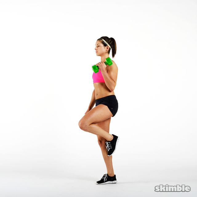 How to do: Dumbbell Right Leg Curl to Press - Step 2