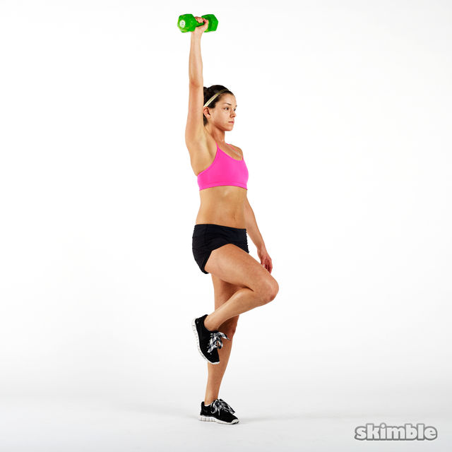 How to do: Dumbbell Single Leg Curl to Press - Step 6