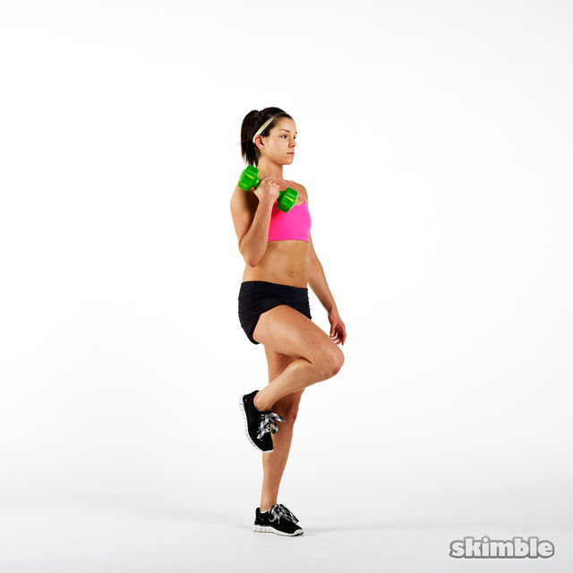How to do: Dumbbell Left Leg Curl to Press - Step 2