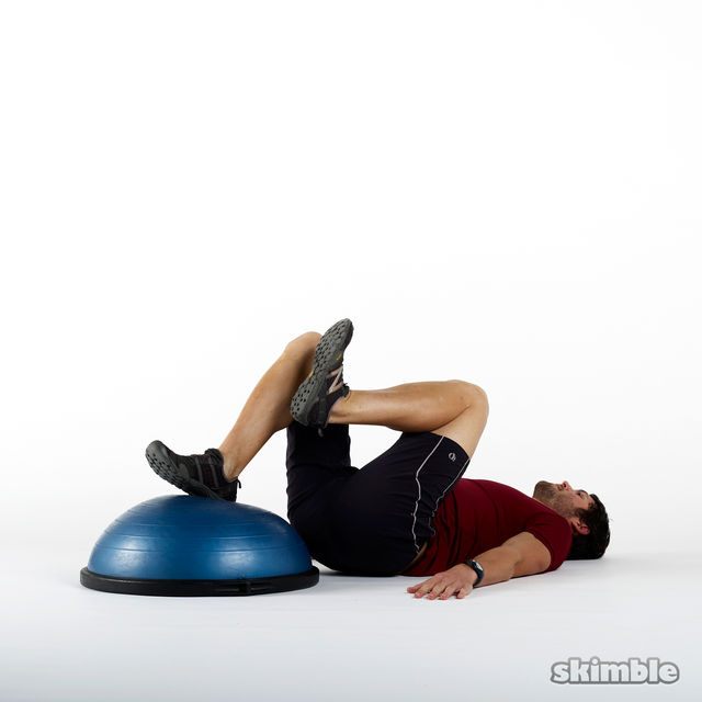 How to do: BOSU Right Leg Floor Bridges - Step 1