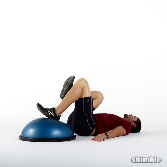 How to do: BOSU Left Leg Floor Bridges - Step 1