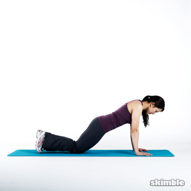 How to do: Elbow Plank with Knee Taps - Step 2