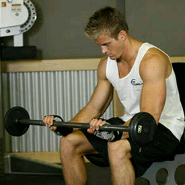 How to do: Seated Palm-down Barbell Wrist Curl - Step 1