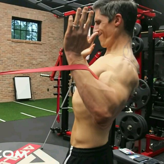 How to do: Back - Band W Pulls with Back Extension - Step 1