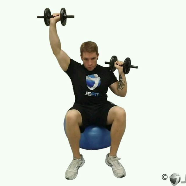 How to do: Alternating Dumbbell Shoulder Press (Stability Ball) - Step 1