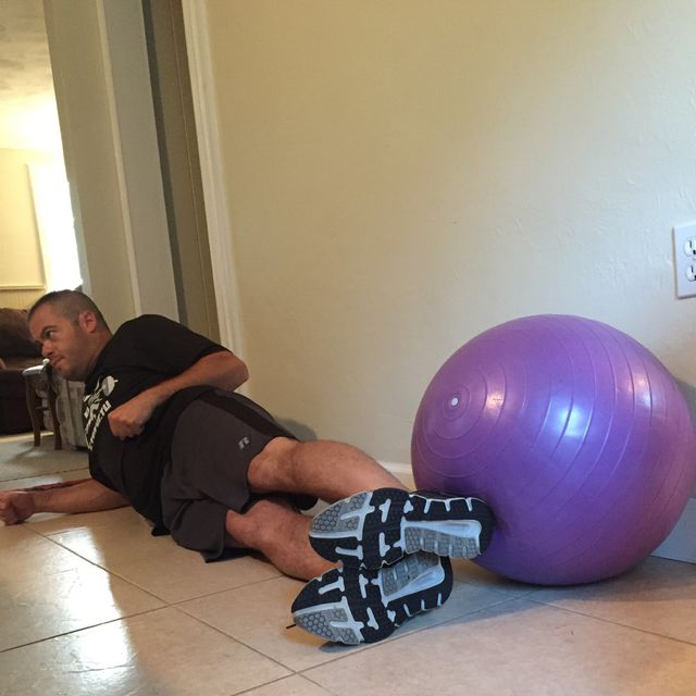 How to do: Swiss Ball Lying Leg Raise - Step 1