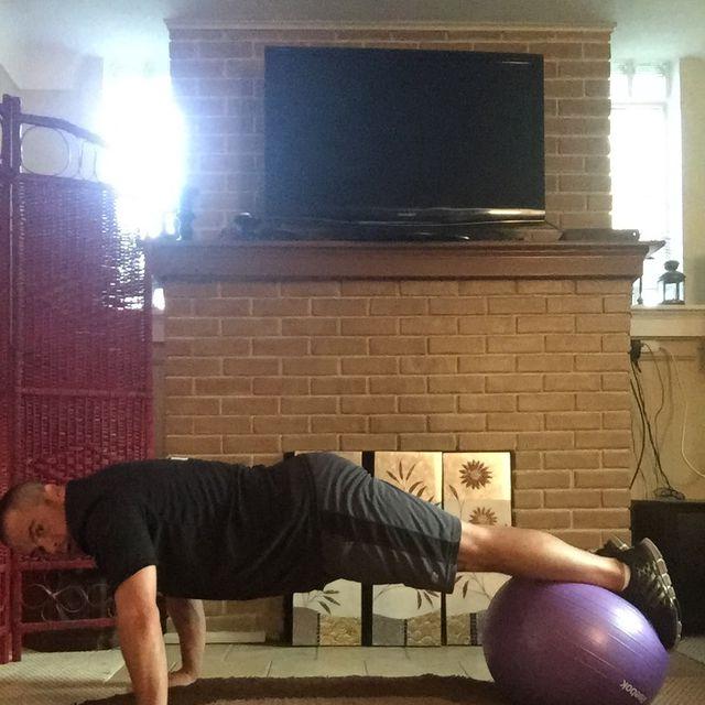 How to do: Swiss Ball Reverse Crunch Pike - Step 1