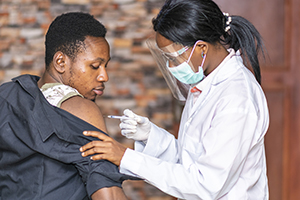 doctor giving vaccine to patient