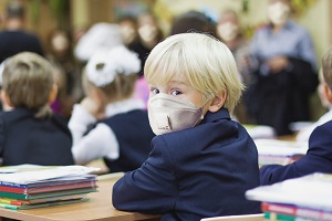 child boy student in protective mask
