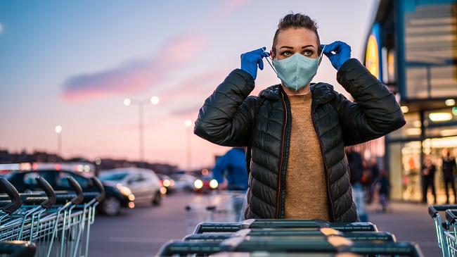 https://stock.adobe.com/images/a-woman-wears-medical-protective-gloves-and-a-mask-while-shopping-groceries/332517690