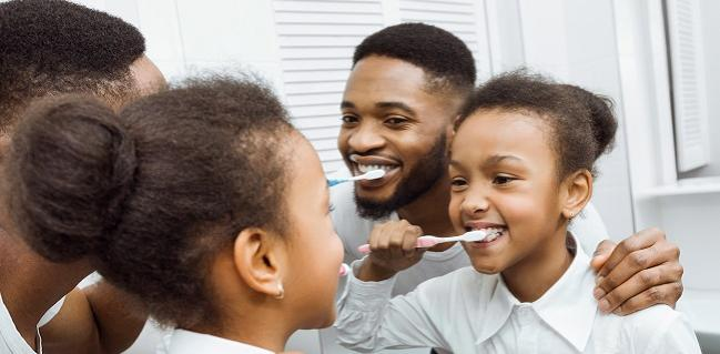 https://stock.adobe.com/images/african-american-girl-brushing-teeth-together-with-dad/247146126