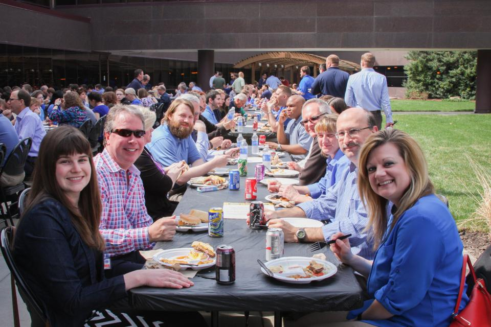 Employee-owners celebrate the founders of Burns & McDonnell, Clinton S. Burns and Robert E. McDonnell, each April with a special luncheon served by the company's leaders.