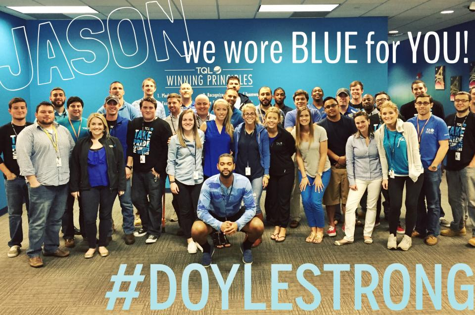 TQL's team Charlotte lends support to a teammate in need