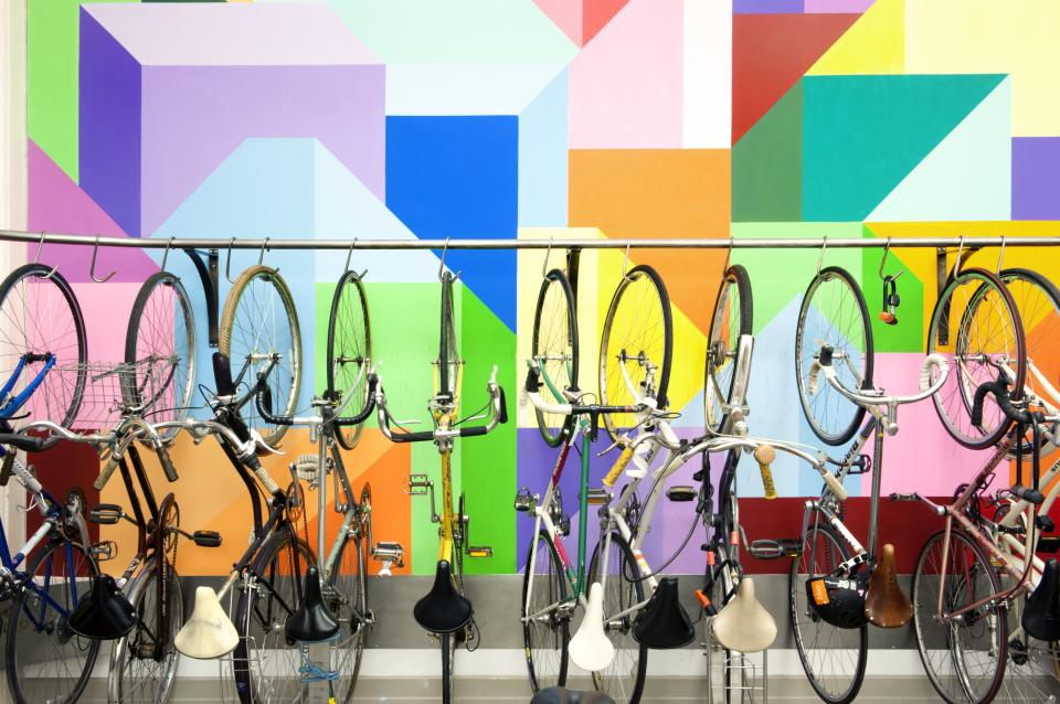 Bikes in our bike room, next to an employee-painted mural.