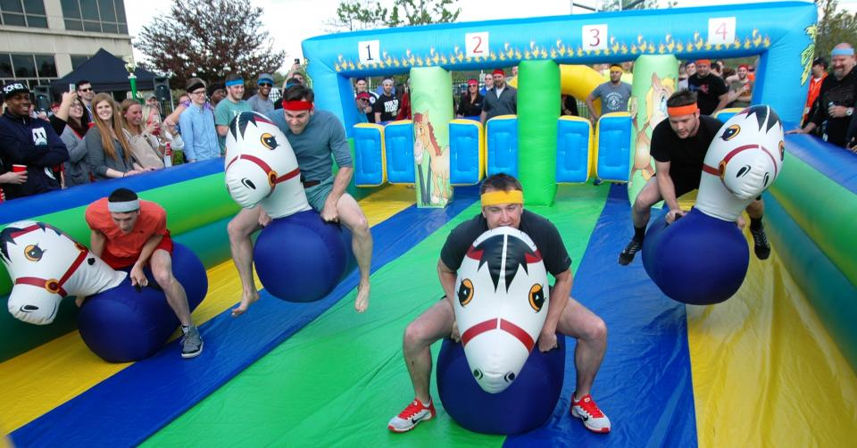 TQL events, like the derby day party, bring employees together for fun and camraderie