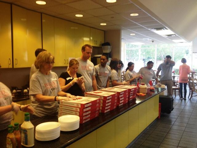 Employees serve dinner at a local Ronald McDonald House, the Firm's charity for 2015.