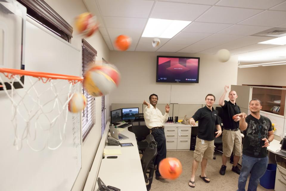 UltiPeeps play Nerf basketball in their offices