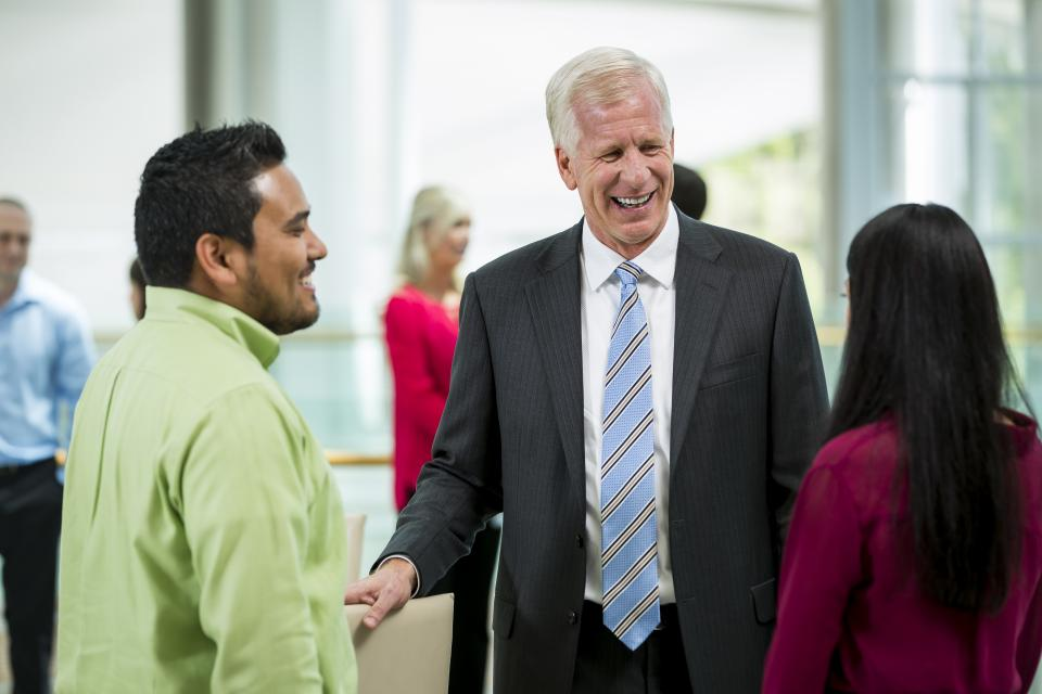 President and CEO Dave Hager interacts with employees
