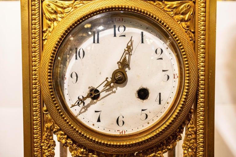 French Empire Gilt Bronze and White Marble Pedestal Floor Clock