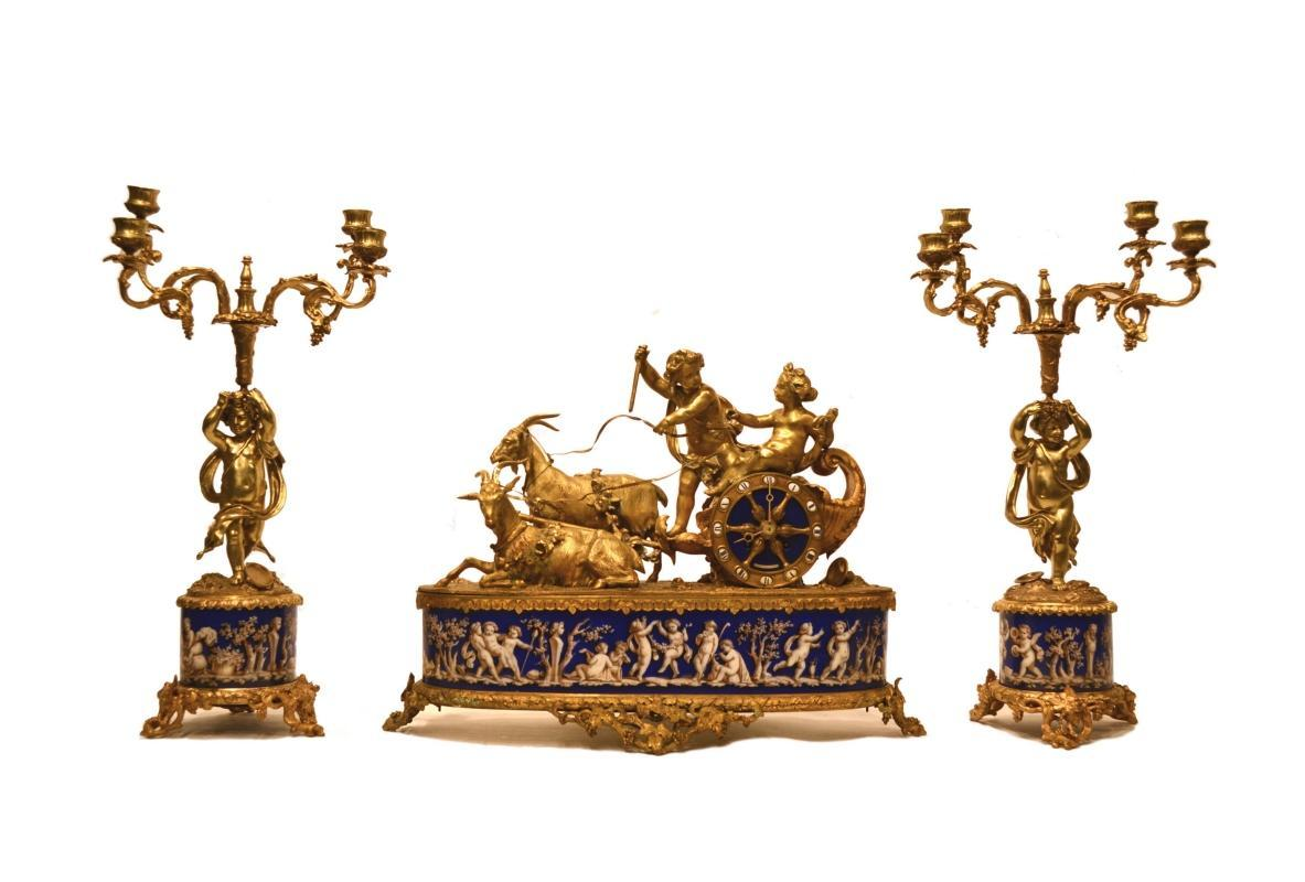 French Porcelain and Gilt Bronze Clock and Candelabra