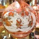 Pair Kutani Bottle Vases with Figurative Covers