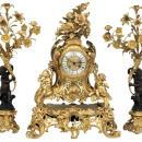 French Louis XV Style Gilt Bronze Clock and Candelabra