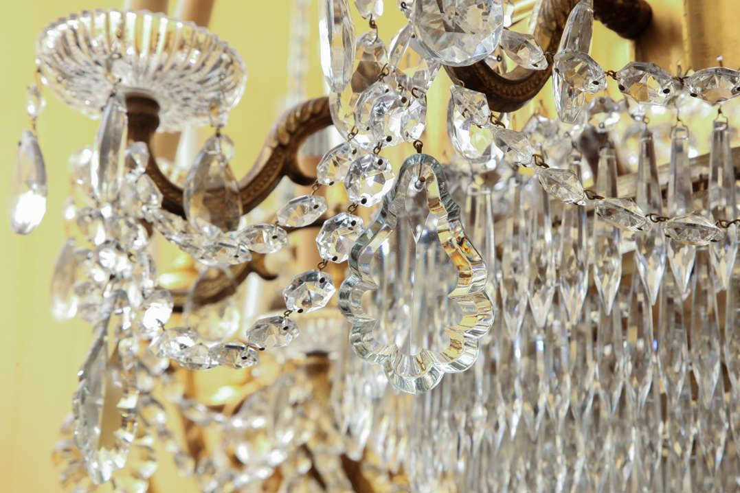 Pair Vintage French Neoclassical Bronze and Crystal Chandeliers