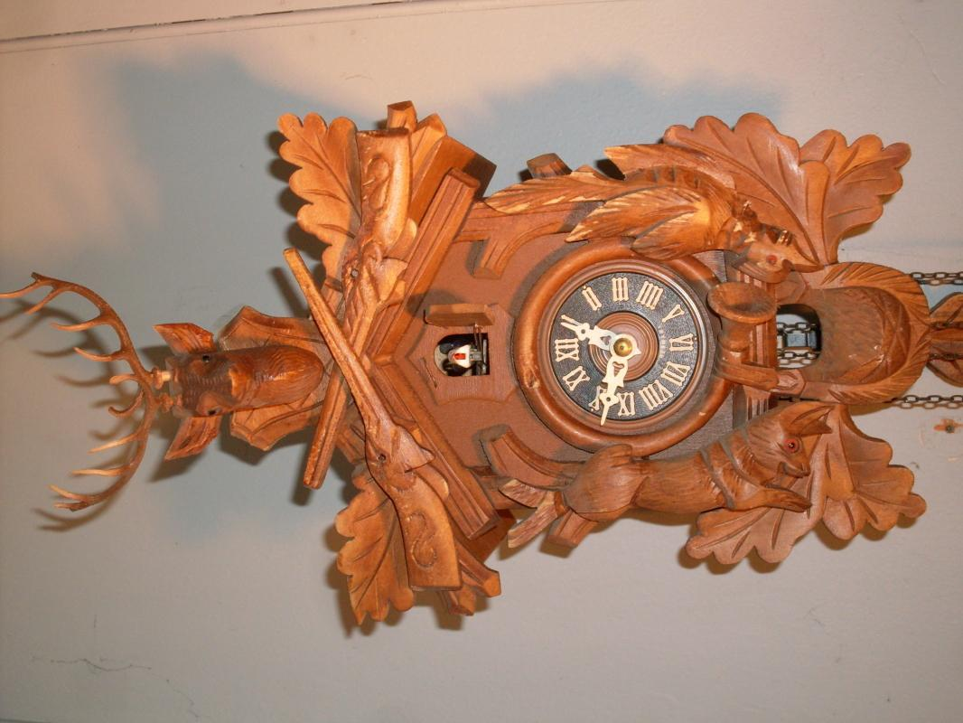 old GERMANY Cockoo CLOCK with Original Pine cone weights. WORKS FINE _Wood cabinet