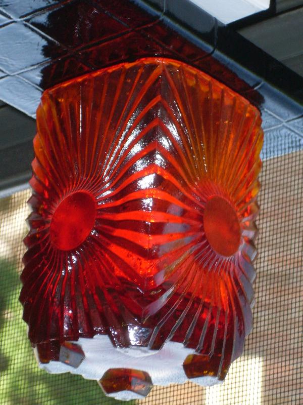Circa 1886 most unusual RIBBED + BULLSEYE + FOOTED AMBERINA Glass toothpick holder , research indicates C.1886 Ribbed effect on outer surface, Reverse Bullseye each at different height on panels. Footed.