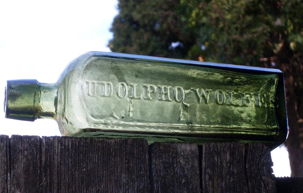 c 1848 - 1880 New York importer UDOLPHO WOLFE'S SCHIEDAM AROMATIC SCHNAPPS  Size 20.32cm X 5.715cm Mottled Green primitive Nice Condition