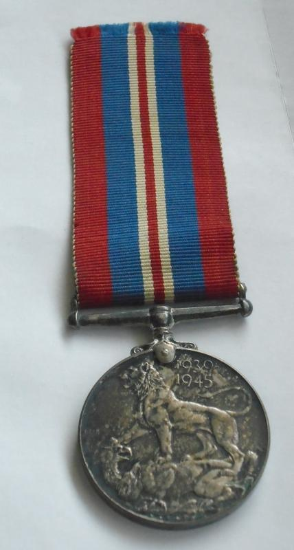1939-1945 WWll SILVER Voluntary Service Medal BRITAIN GEORGIVS _ Medal ORIGINAL with original Red White Blue Ribbon.