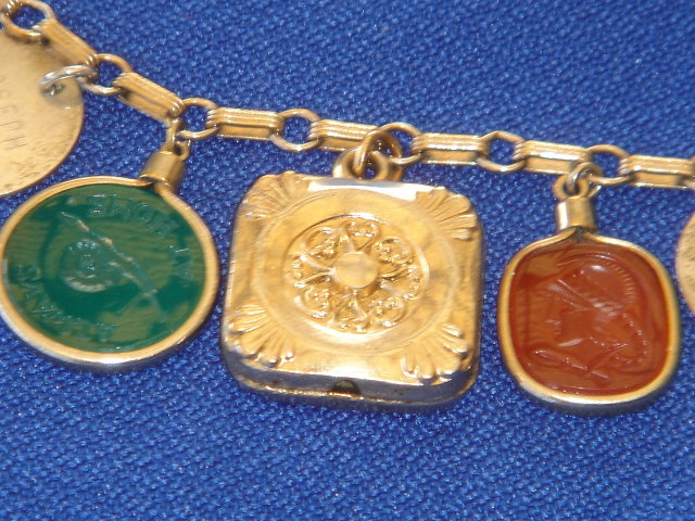 ~ Beautiful CHARM BRACELET ~ Leonore Doskow ~Hand Made Sterling Silver ~3 Gold Perfume Vials~ Victorian Era GOLD Hallmarked Watch FOB + 2 Translucent Green +  1 Tobacco Brown + 2 Black Intaglios Ancient Soldiers