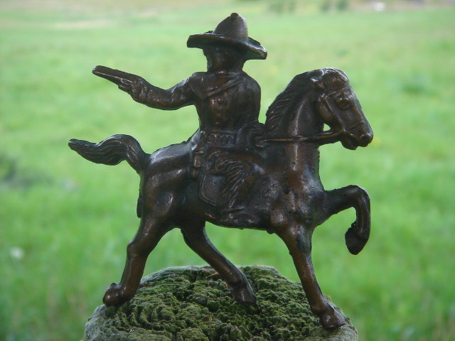 Bronze style Western Cowboy shooting a handgun while mounted on his  Galloping Horse__RARE Find in Miniature. SOLID CAST FIGURE Not Hollow__Excellent Condition.
