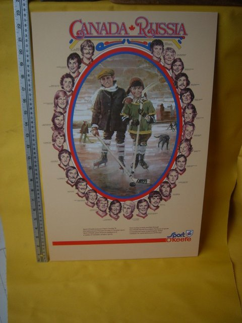 Professionally DRY MOUNTED POSTER ART _Sports Memorabilia Vintage 1974 Team CANADA vs Russia HOCKEY Poster Features   Paul Henderson  # 19 Team Canada etc AND One Canada Russia Mini WOODEN HOCKEY STICK_ Professionally Dry Mounted_ Size 23