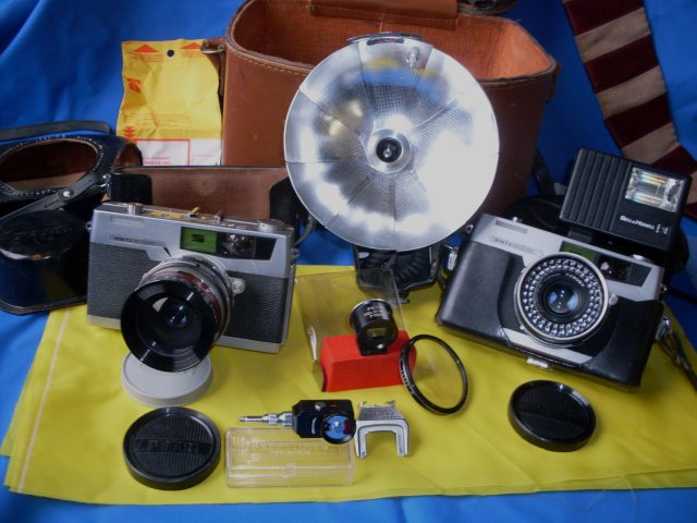 Camera Collector / Camera Buffs Still Make Use __TWO _ 2 _ Petri 7s- 1963 JAPAN Rangefinder Cameras CIRCLE-EYE Green System Cameras + Case & Lots of attachments