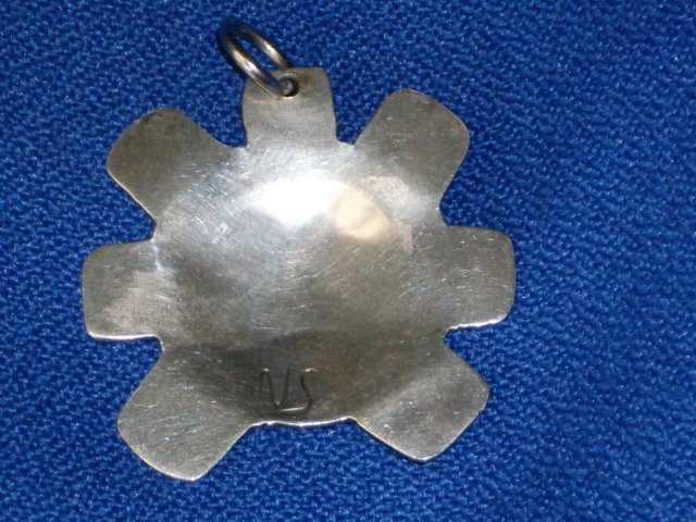 old British Columbia _1st. Nations _Indian _Native Art in Sterling Silver . Sun Spirit Mask symbol pendant . The Skill of Native carver. Beautiful. Monogram signature ( N S )  Circa 1970