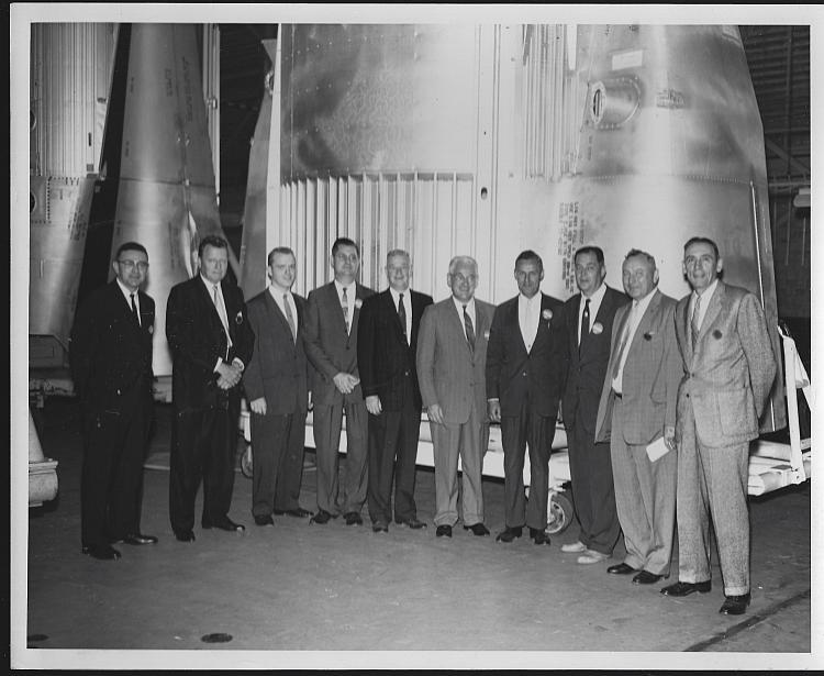 Original Photograph of Large Group of Men Standing in Front of Saturn Engine
