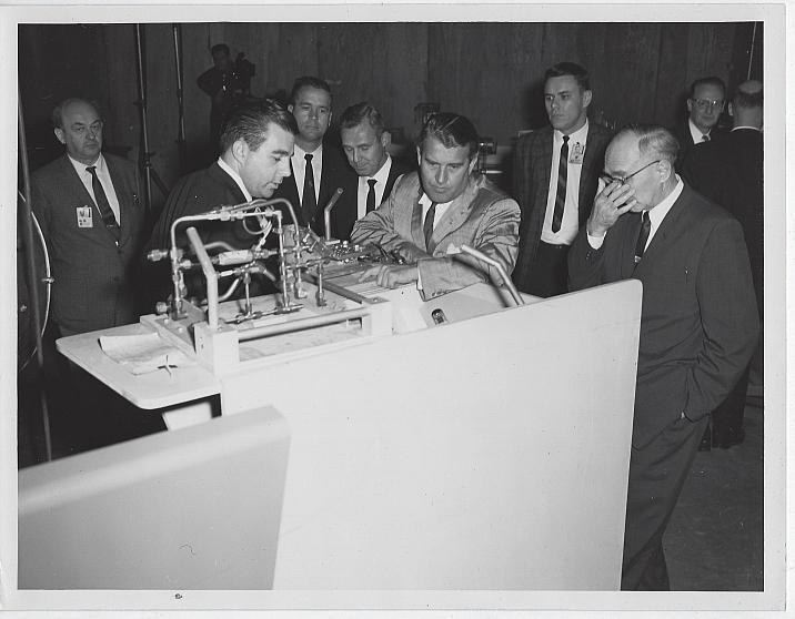 Original Photograph of Wernher Von Braun and Other Men Looking at Saturn Rocket
