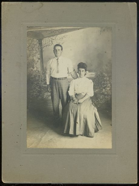 Cabinet Card of Serious Looking Couple