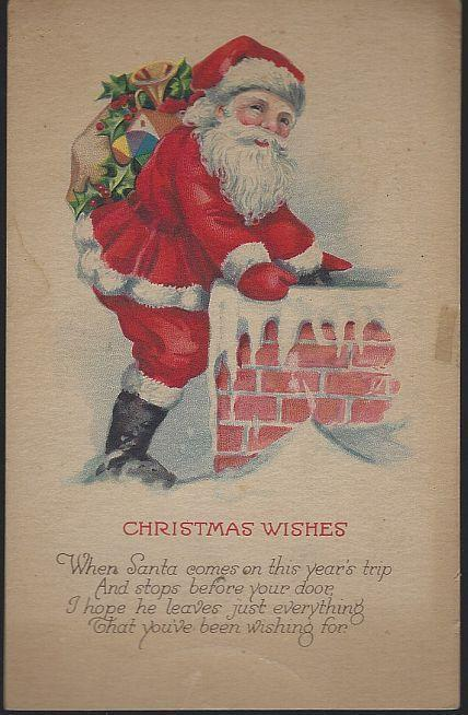 Vintage Christmas Wishes Postcard with Santa Claus on Roof Going Down Chimney