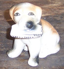 Vintage Pottery Dog Figurine with Newspaper in Mouth