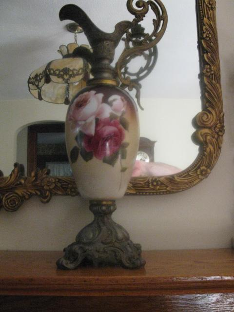 matched pair of hand painted roses ewers