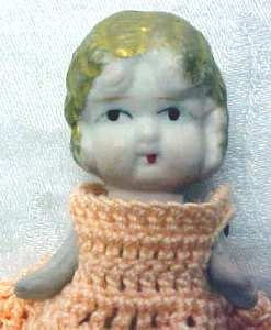 All Bisque Miniature Doll  Peach Dress