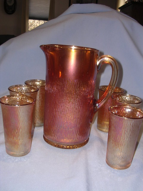 IMPERIAL TREE BARK MARIGOLD IRIDIZED CARNIVAL GLASS TANKARD PITCHER AND 6 TUMBLERS