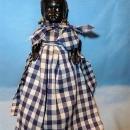 VINTAGE BLACK HARD PLASTIC DOLL DRESSED IN GINGHAM