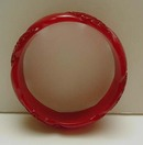Bakelite Twisted and Carved Persimmon Colored Bangle
