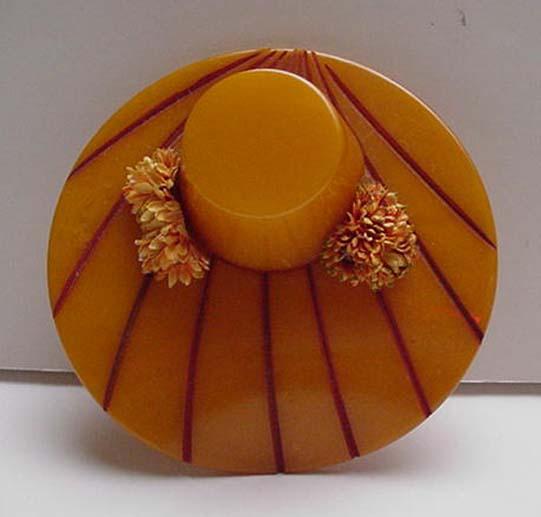 Bakelite vintage hat with flowers brooch