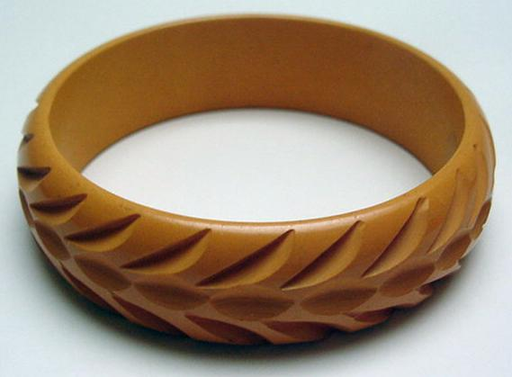 Bakelite butterscotch carved bangle