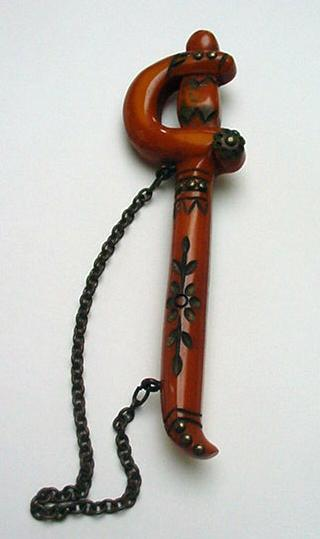 Bakelite Carved Sword