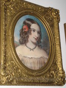 Mid-Nineteenth Century American Pastel on Paper Laid Down on Board of a Beautiful Young Lady with a Flower in Her Hair